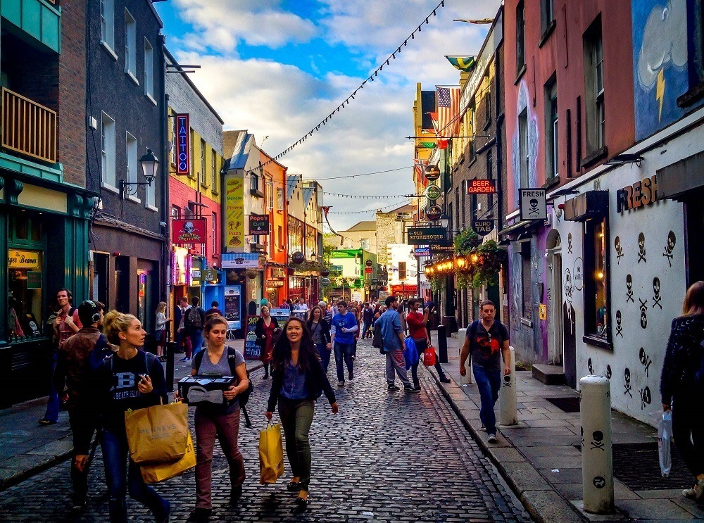 People walking near Temple Bar at dusk