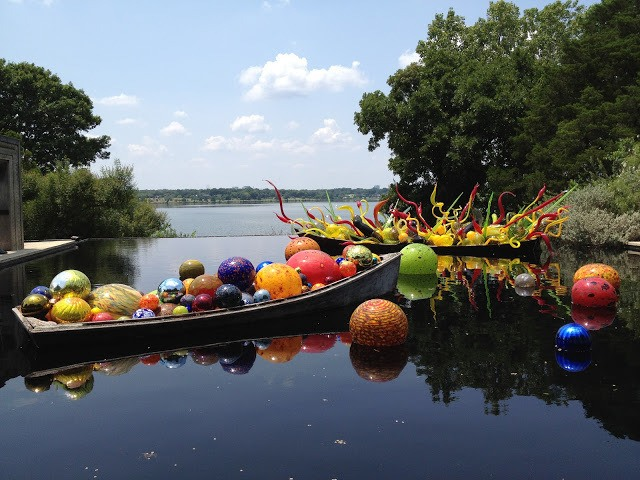 Chihuly glass exhibit of colorful balls in water at the Dallas Arboretum