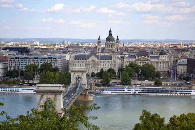 Overhead view of the chain bridge, castle, and Danube River in Budapest