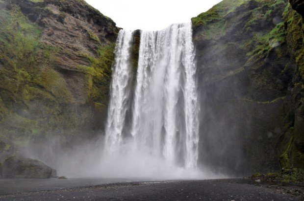 How to spend a week in Iceland?  This Iceland itinerary makes it easy!  Follow this ultimate Iceland road trip itinerary as you visit waterfalls, fjords, glaciers, and small villages all while touring Iceland by car.  This is one of the highlights:  the Skogafoss waterfall in Southern Iceland, our first stop driving Iceland's Ring Road