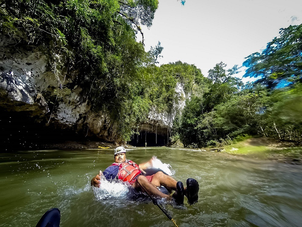 Cave Tubing in Belize - Get Those Butts Up! - Travel Addicts