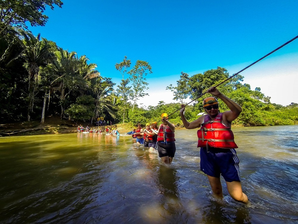 The first obstacle to cave tubing is getting across the Caves Branch River in Belize
