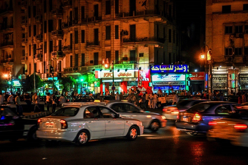 Cars and protesters in Tahrir Square in Cairo