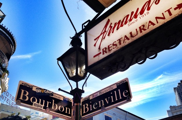 Arnaud's sign with Boubon & Bienville sign in French Quarter