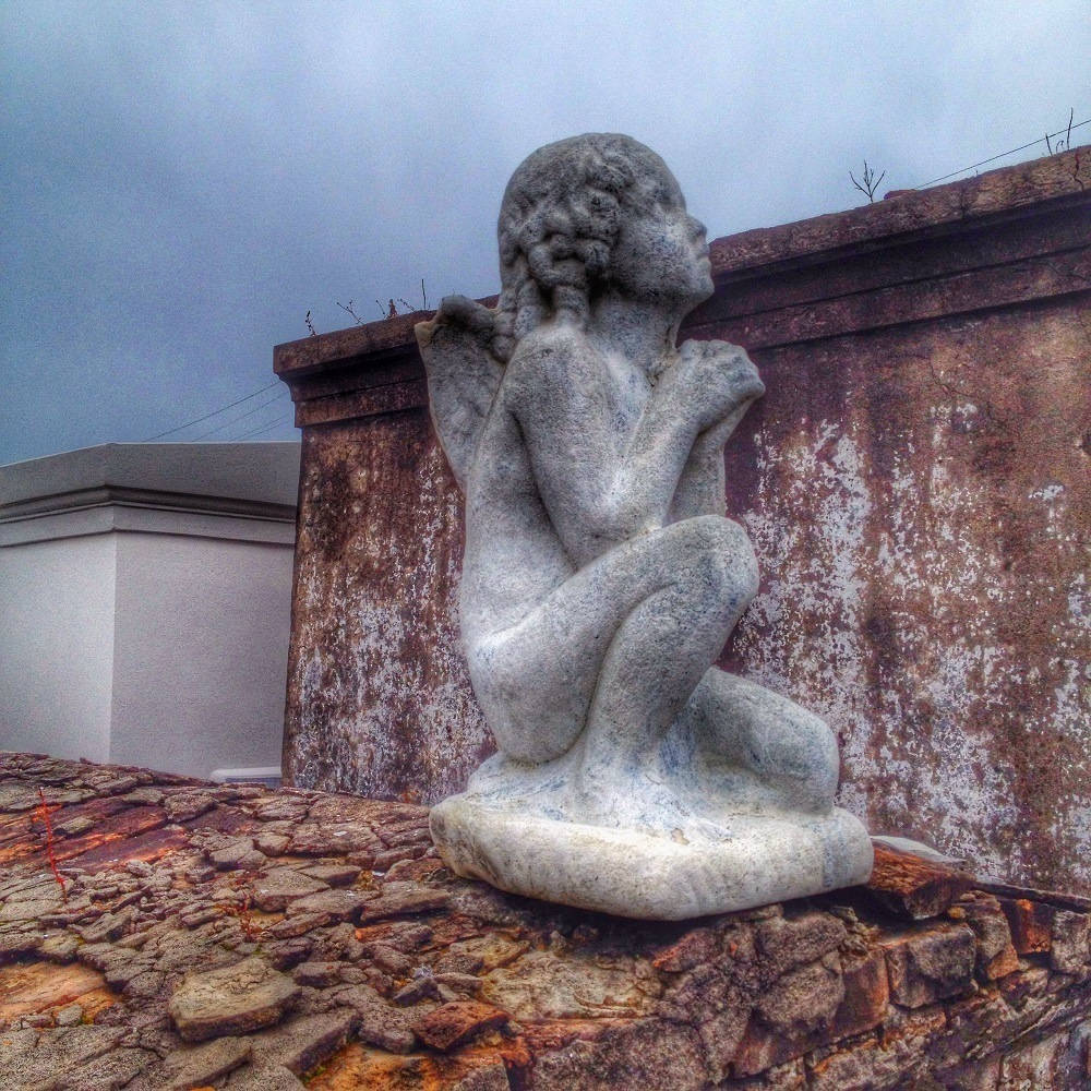 The best cemetery New Orleans: Cherub on a tomb in St. Louis Cemetery No. 1