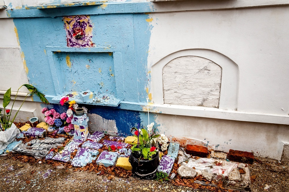 Above-ground tomb painted blue