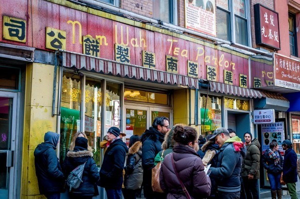 Experiencing the original egg roll on a New York food tour at Nom Wah