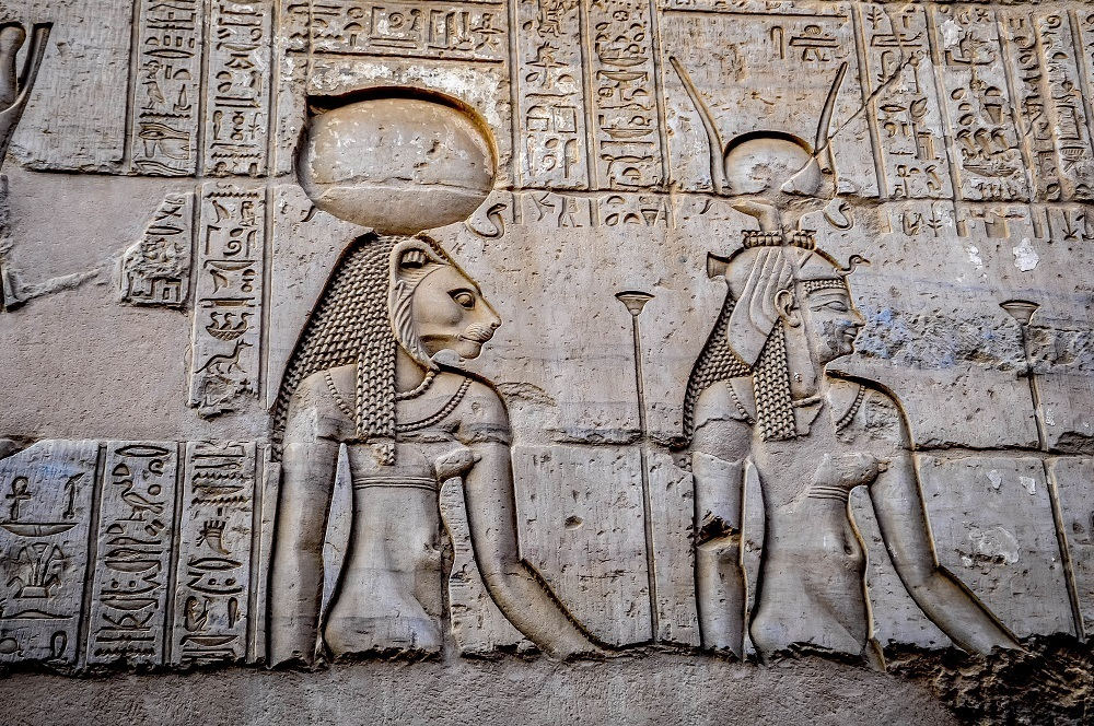 Close up of two carved reliefs of Egyptian gods at Kom Ombo in Egypt