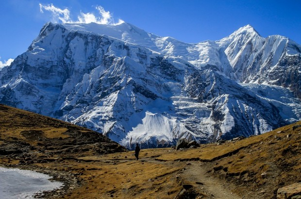 Man walking in the Himalayan Kingdom of Nepal near Braka