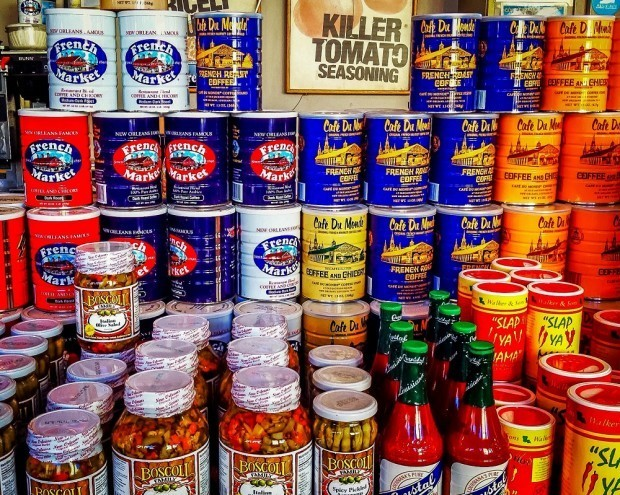 Coffee cans and jars of spices and peppers on display at the French Market. Visiting here is a highlight of a New Orleans weekend trip.