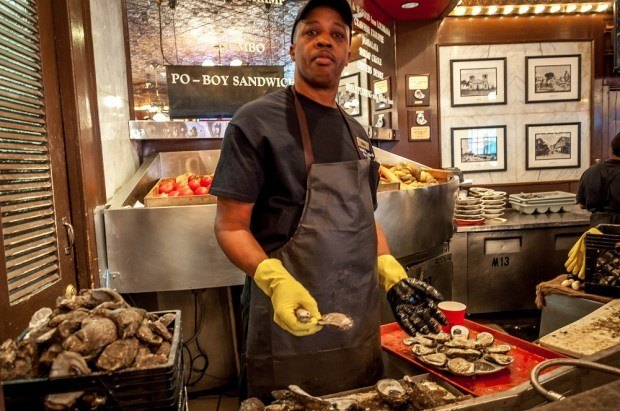 Man shucking an oyster on Bourbon Street