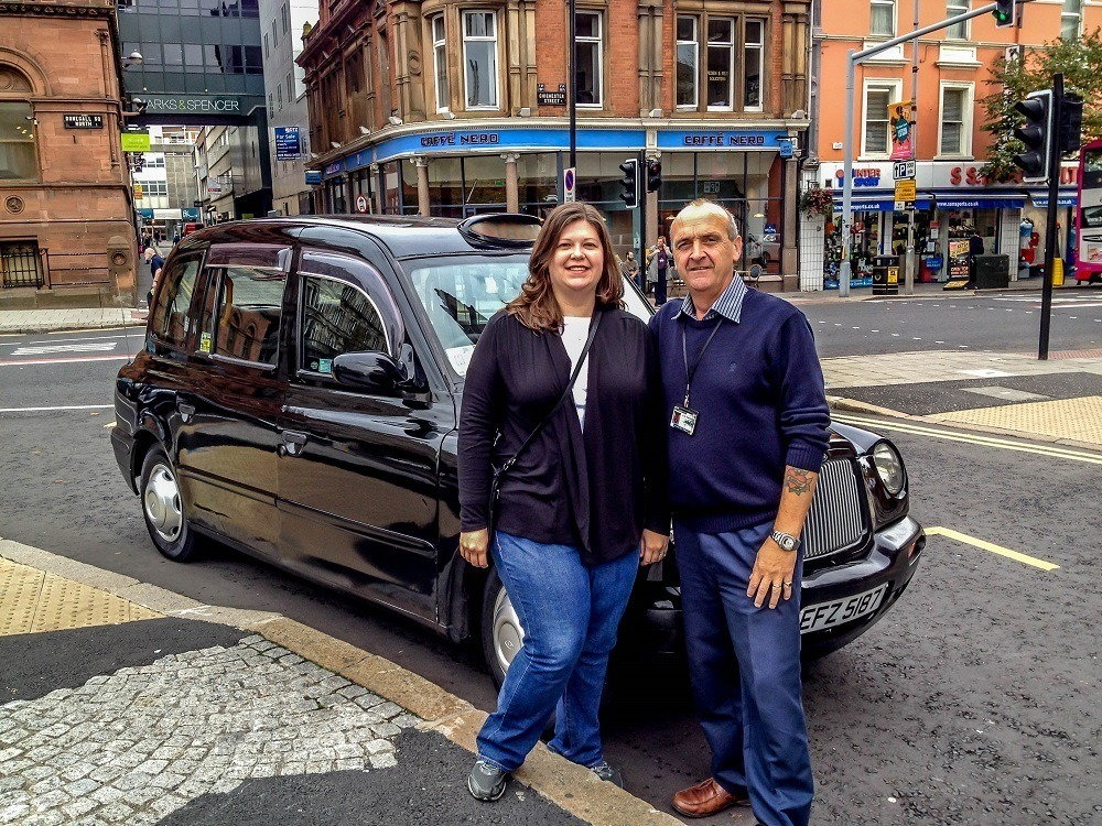 Laura and Paddy Campbell, in front of classic black cab