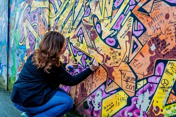 Laura signing the Peace Wall