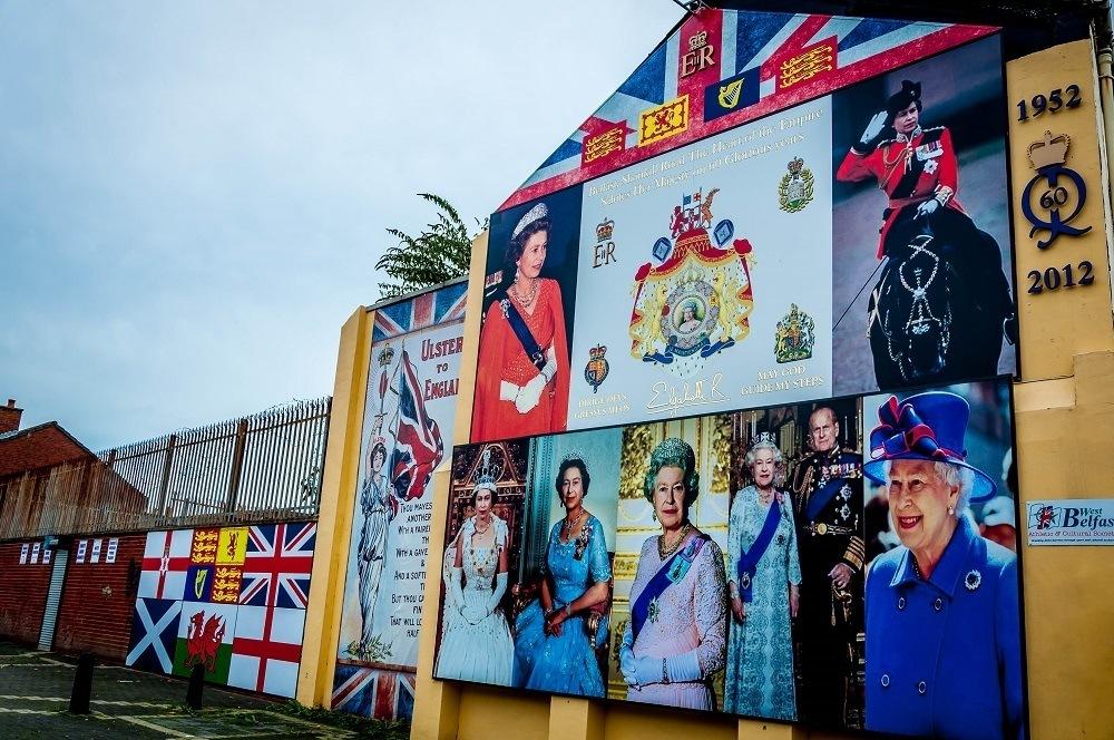 Mural showing several images of UK's Queen Elizabeth in Belfast, Northern Ireland