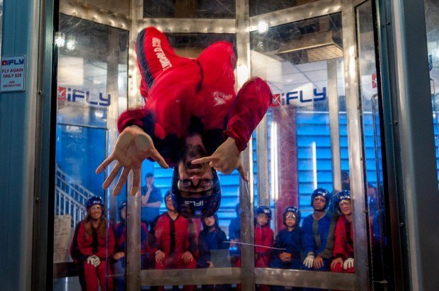 An instructor at iFLY Orlando demonstrating cool moves in the wind tunnel