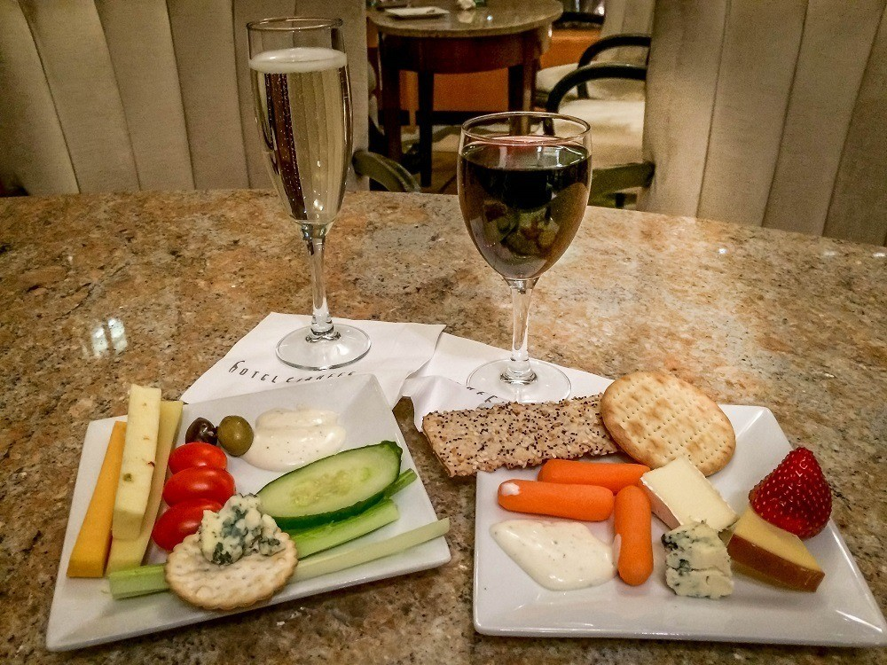 Glasses of wine and plates of cheese and vegetables at The Happy Hour