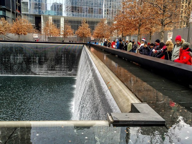 Visitors at one of the pools of the September 11 Memorial