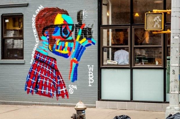Paparazzi street art on a Lower East Side walking tour.
