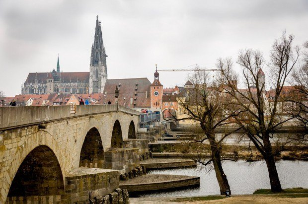 The skyline of Regensburg, with the twin spires of Dom St. Peter, as viewed from the Steinerne Brucke (Stone Bridge).