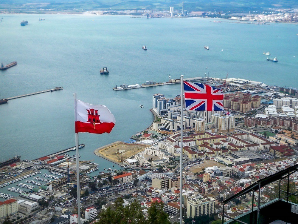 View of the harbor in Gibraltar with flags