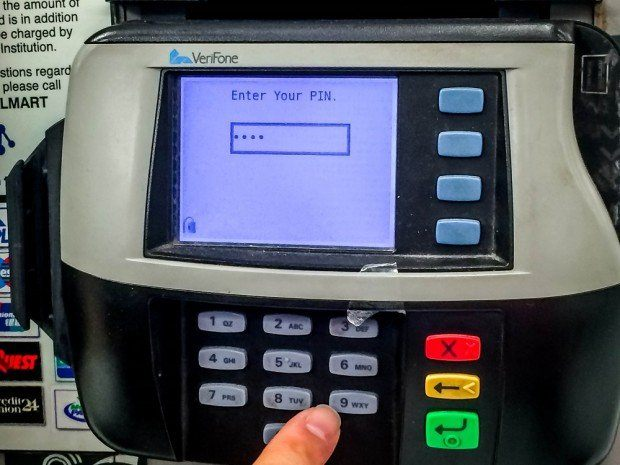 Select and enter your PIN on the keypad at the Walmart ATM for your Visa gift card.