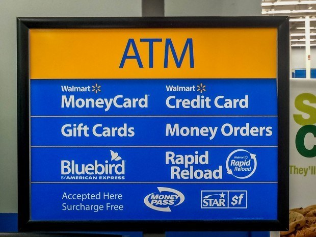 The sign for the Walmart ATM and kiosk where you can add money from your travel hacking gift card onto your Bluebird account.