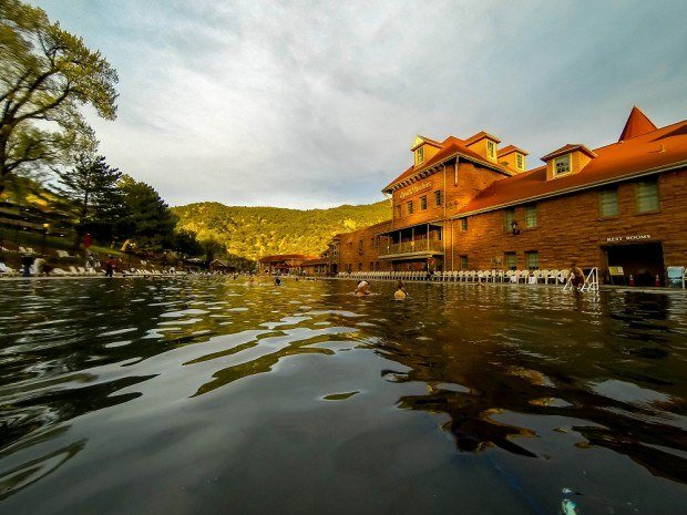 At dusk, the sun sets on the mountains around the Glenwood Springs pool