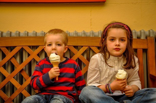 Two young Irish children enjoying their ice cream at the Powerscourt Gardens outside of Dublin, Ireland.