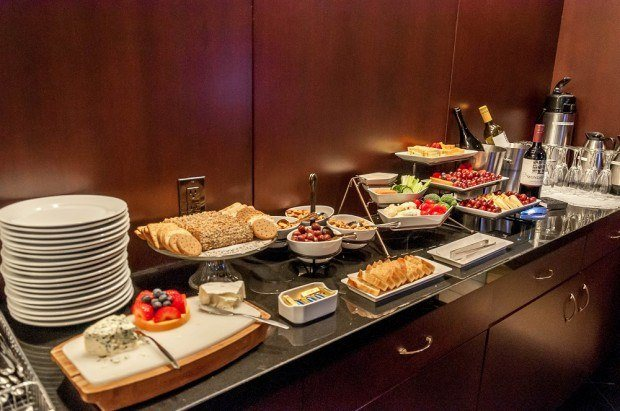 The complimentary happy hour at New York's Library Hotel features snacks, wine and cold beverages.