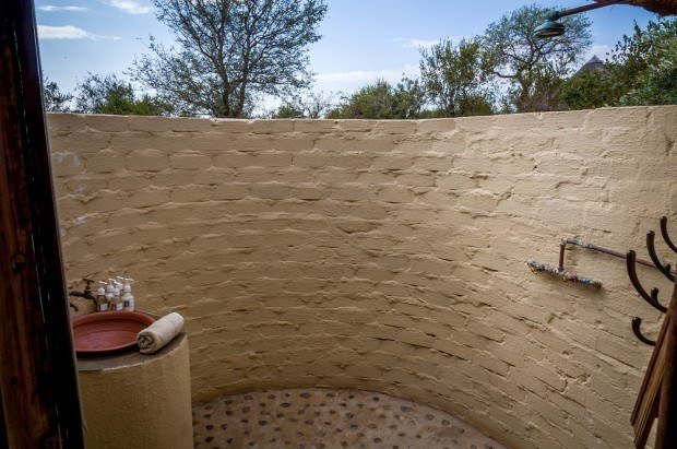 Each rondavel at Africa on Foot has an outdoor shower - so you can look out on the Klaserie Private Nature Reserve.