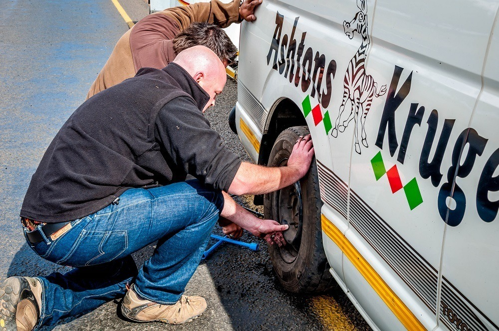 On our way to our South Africa safari, our shuttle transfer had a flat tire, but it was quickly fixed.