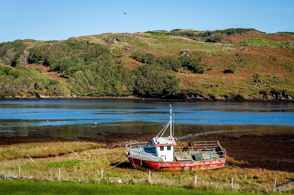 An Ireland coastal drive around Donegal brings dramatic landscapes and unexpected sights