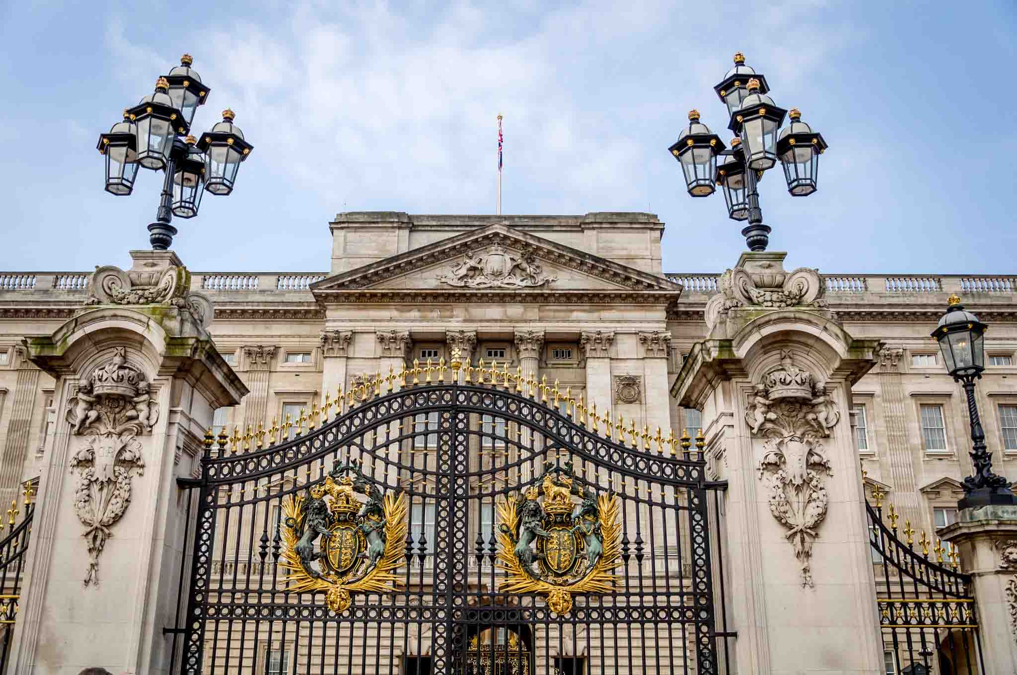 Buckingham Palace and its gates with gold crests seen on a long Heathrow Layover