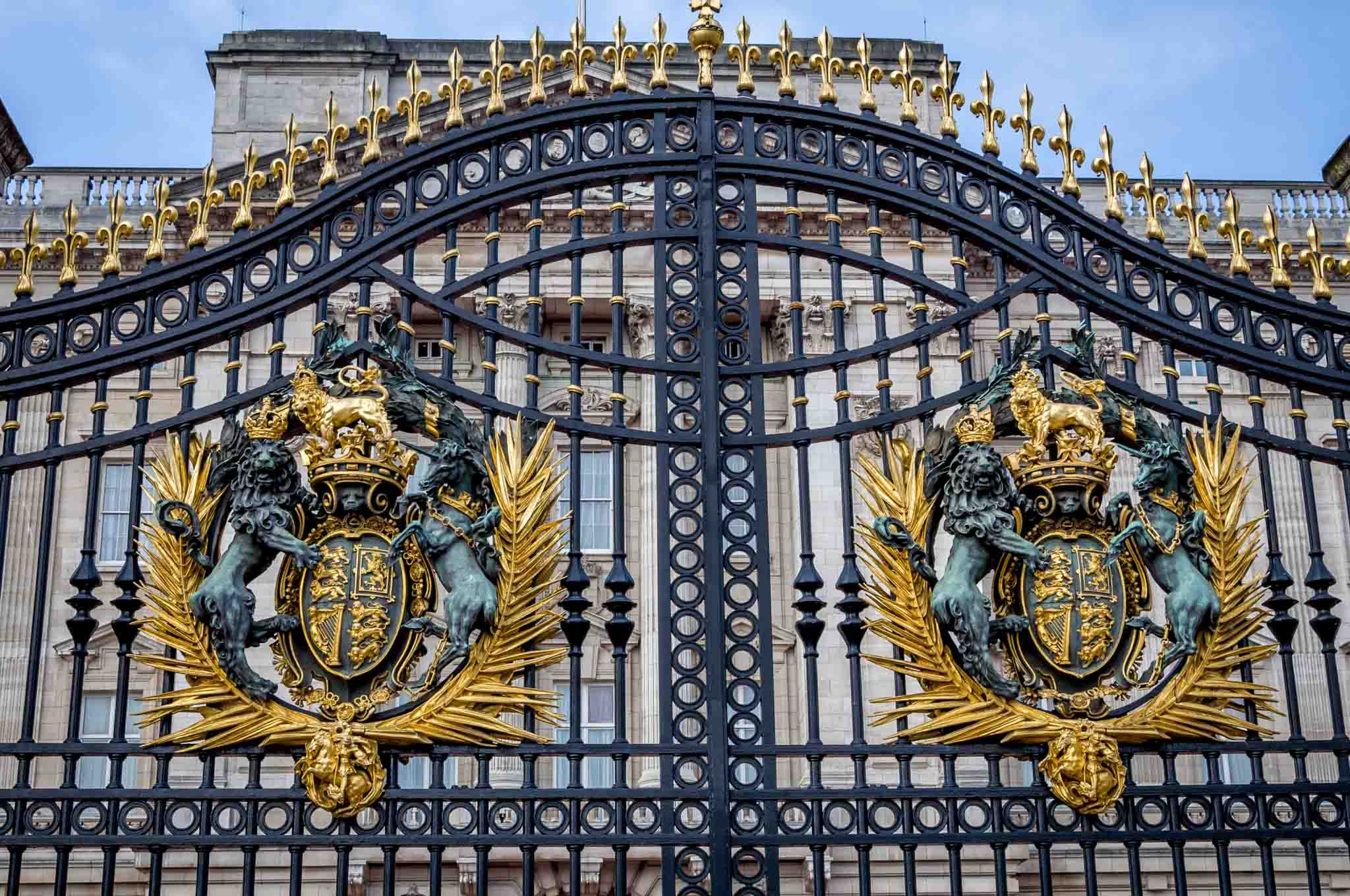 Seeing the Gates on Buckingham Palace in London. We wondered: Can I leave the airport during a layover? Turns out, yes!  Take the LHR to London train and explore the city.