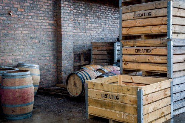Grape crates and wine barrels at Creation Wines outside of Hermanus, South Africa. We thought the Creation Wines prices were very reasonable and bought several bottles to take home with us.