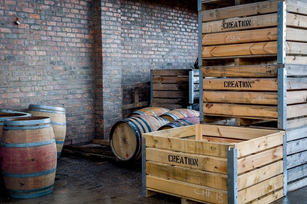 Wooden grape crates and wine barrels at Creation Wines