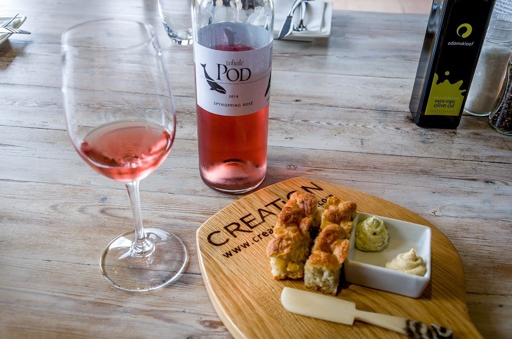 Bottle and glass of Whale Pod Spyhopping Rose wine in the Hemel en Aarde Valley