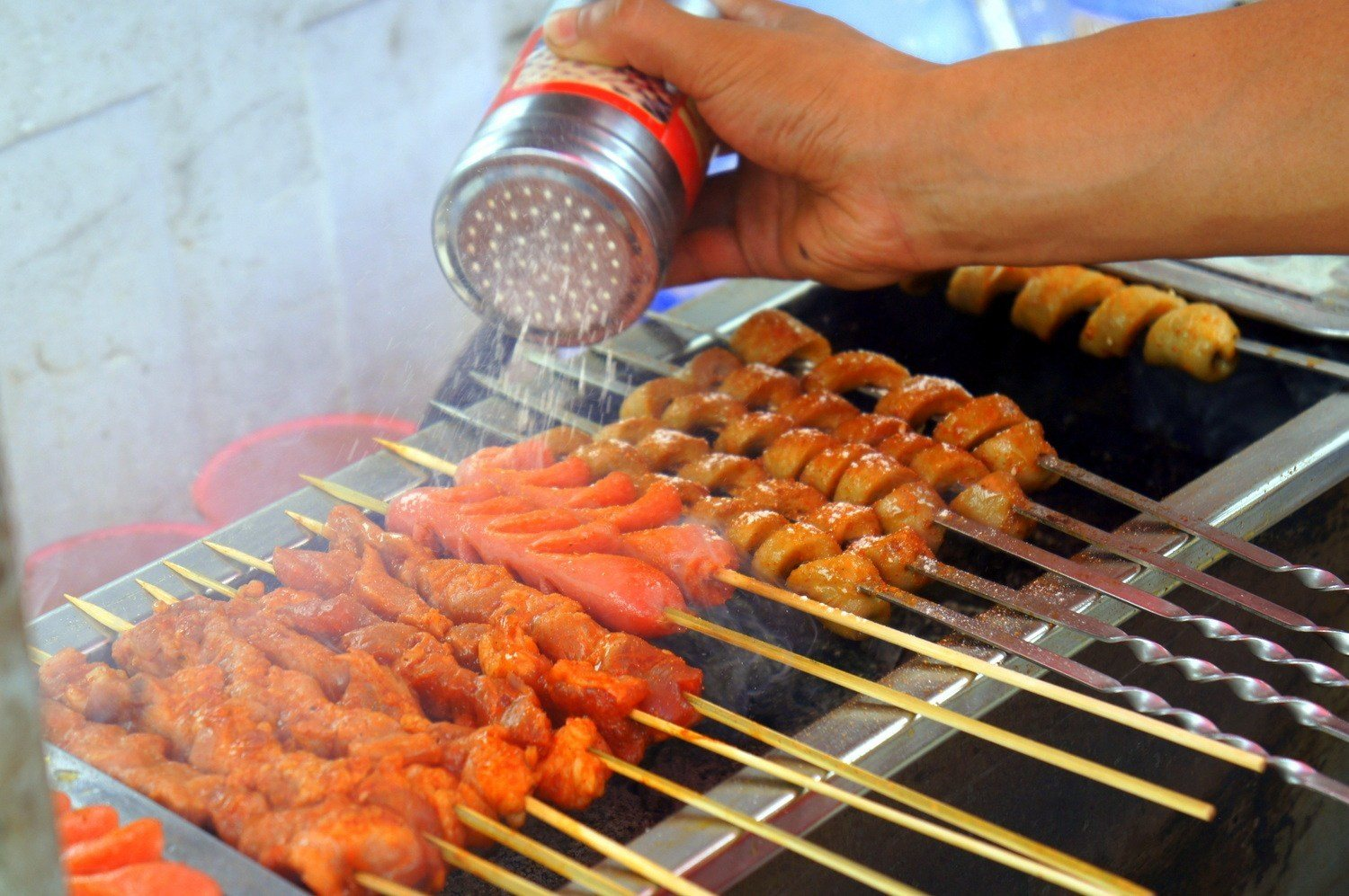 BBQ street food in the night markets of Da Lang, Dongguan, China.  This is one of the highlights of Dongguan expat life.