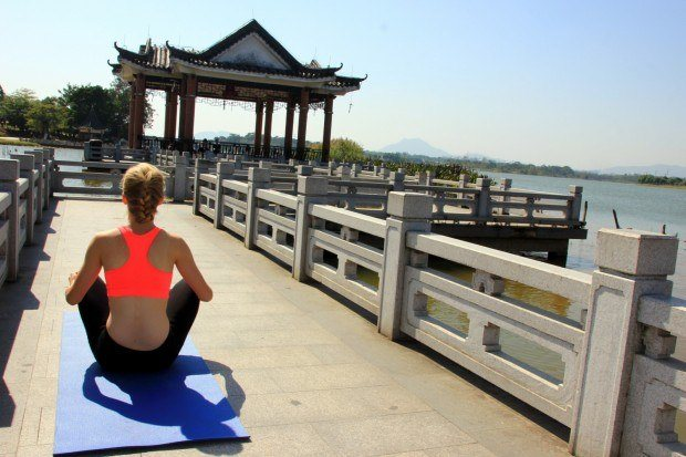 Agness Walewinder of eTramping practicing yoga at Songshan Lake, part of her Dongguan expat life.