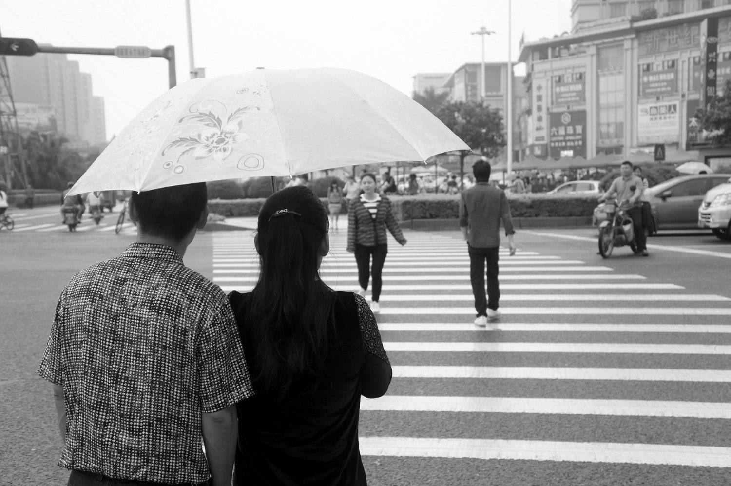 """Lovers out for a stroll in Dongguan, the """"Sex Capital of China"""" (this is China's """"sin city"""")"""