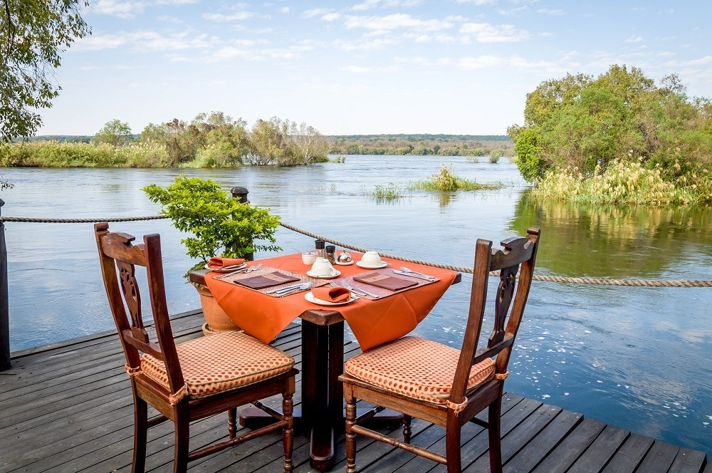 Al fresco dining at the river's edge at the Islands of Siankaba