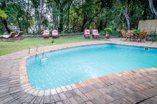 The swimming pool at the Islands of Siankaba luxury lodge outside of Livingstone, Zambia.