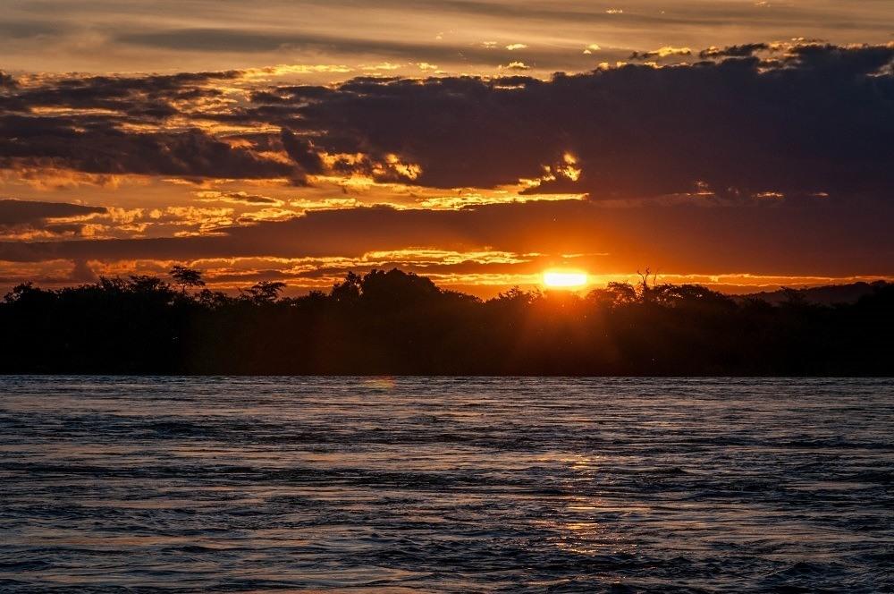 Sunset over the Zambezi River in Zambia.