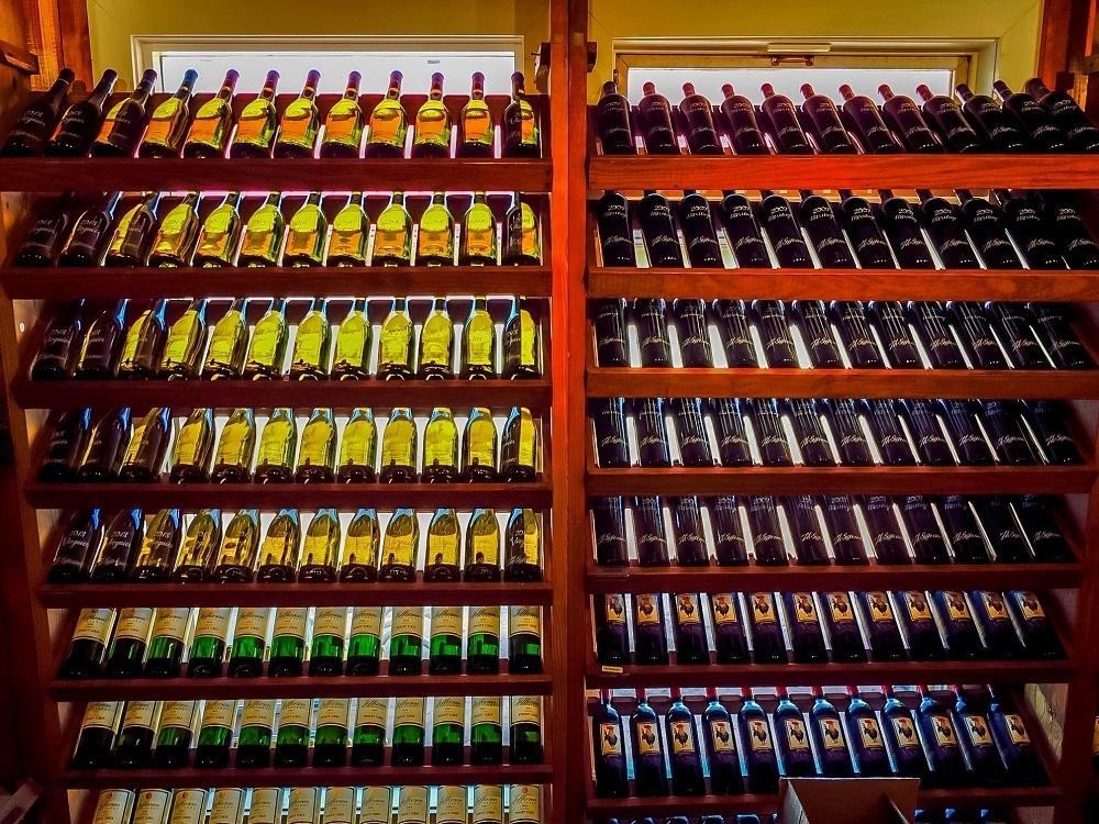 Racks with bottles of wine
