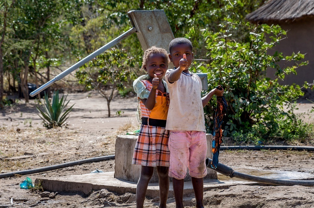 Girls in the village of Siankaba at the new water well.  This is much safer than getting water out of the Zambezi River with all of the crocodiles.