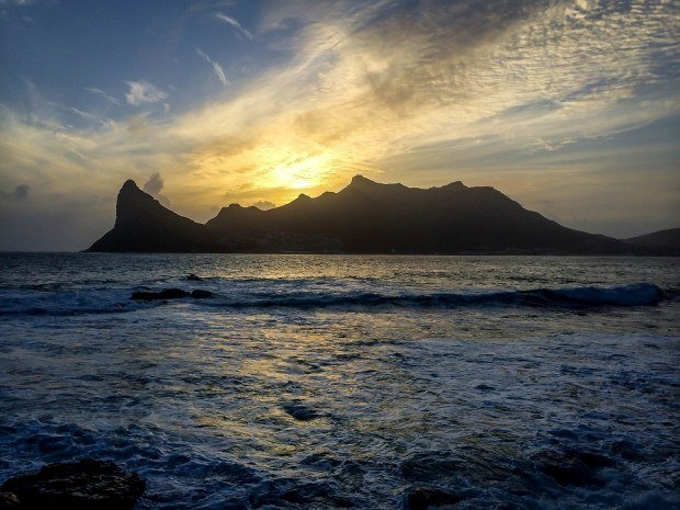 Sunset over Hout Bay, Cape Town from The Tintswalo Atlantic hotel off Chapman's Peak Drive. This is the perfect base to explore Table Mountain National Park South Africa.
