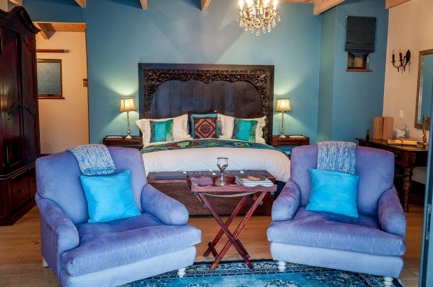 The bedroom at The Tintswalo Atlantic Hout Bay.  The large sitting chairs look out on the Atlantic Ocean and we could sit forever watching the waves.