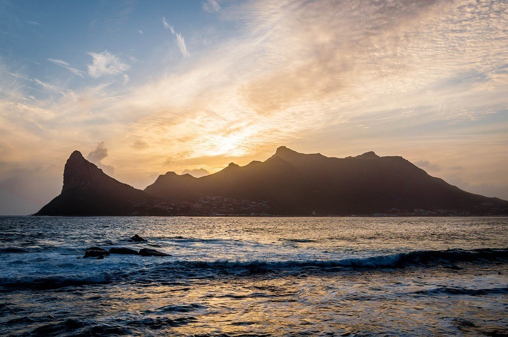 Sunset over Sentinel Peak and Hout Bay from The Tintswalo Atlantic Cape Town lodge.