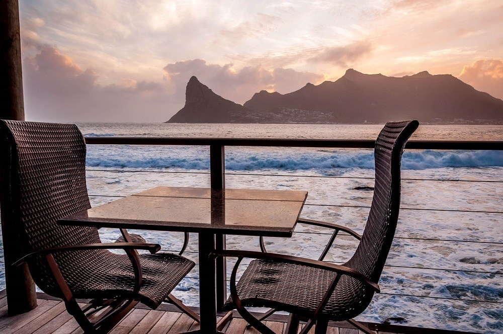 Sunset from our balcony at Tintswalo Atlantic looking out over Hout Bay and Sentinel Peak. Nearly every one of the Tintswalo Atlantic reviews mentions this incredible view.