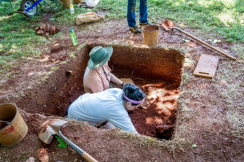Two women conducting archaeological excavations on Mulberry Row
